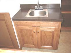 Sink cabinet & laminate top in back of bar