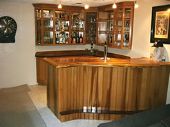 "White oak ""S""-shaped bar and cabinets"