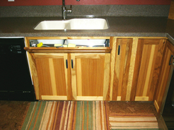 Sink tip-out drawer
