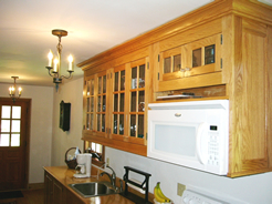 Wall cabinets accommodate microwave